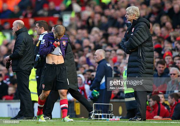Arsenal Manager Arsene Wenger looks on as Jack Wilshere of Arsenal heads for the dressing room after being sent off during the Barclays Premier...