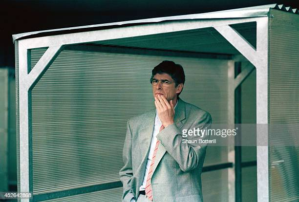 GERMANY Arsenal manager Arsene Wenger looks on circa 1996