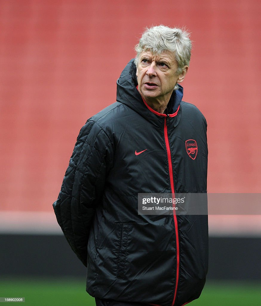 Arsenal manager <a gi-track='captionPersonalityLinkClicked' href=/galleries/search?phrase=Arsene+Wenger&family=editorial&specificpeople=171184 ng-click='$event.stopPropagation()'>Arsene Wenger</a> looks on during a training session at Emirates Stadium on January 03, 2013 in London, England.