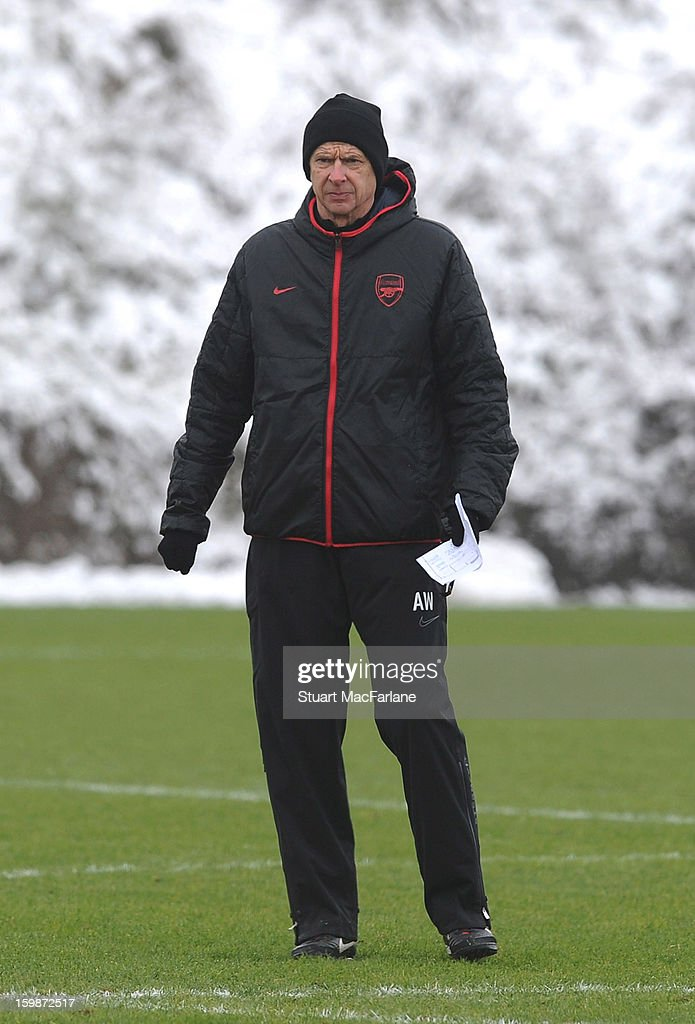 Arsenal manager <a gi-track='captionPersonalityLinkClicked' href=/galleries/search?phrase=Arsene+Wenger&family=editorial&specificpeople=171184 ng-click='$event.stopPropagation()'>Arsene Wenger</a> looks on during a training session at London Colney on January 22, 2013 in St Albans, England.