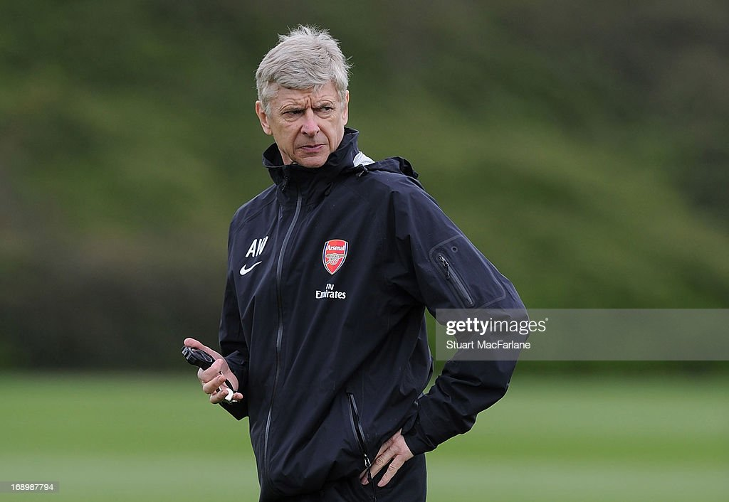Arsenal manager Arsene Wenger looks on during a training session at London Colney on May 18, 2013 in St Albans, England.