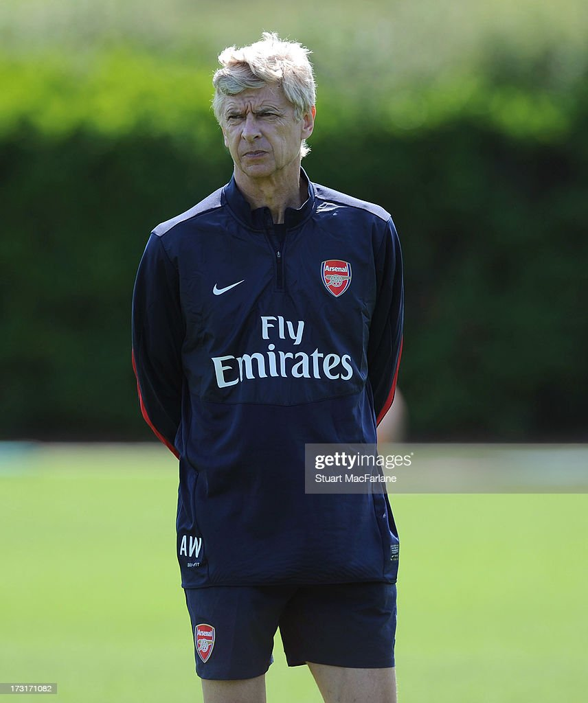 Arsenal manager <a gi-track='captionPersonalityLinkClicked' href=/galleries/search?phrase=Arsene+Wenger&family=editorial&specificpeople=171184 ng-click='$event.stopPropagation()'>Arsene Wenger</a> looks on during a training session at London Colney on July 09, 2013 in St Albans, England.