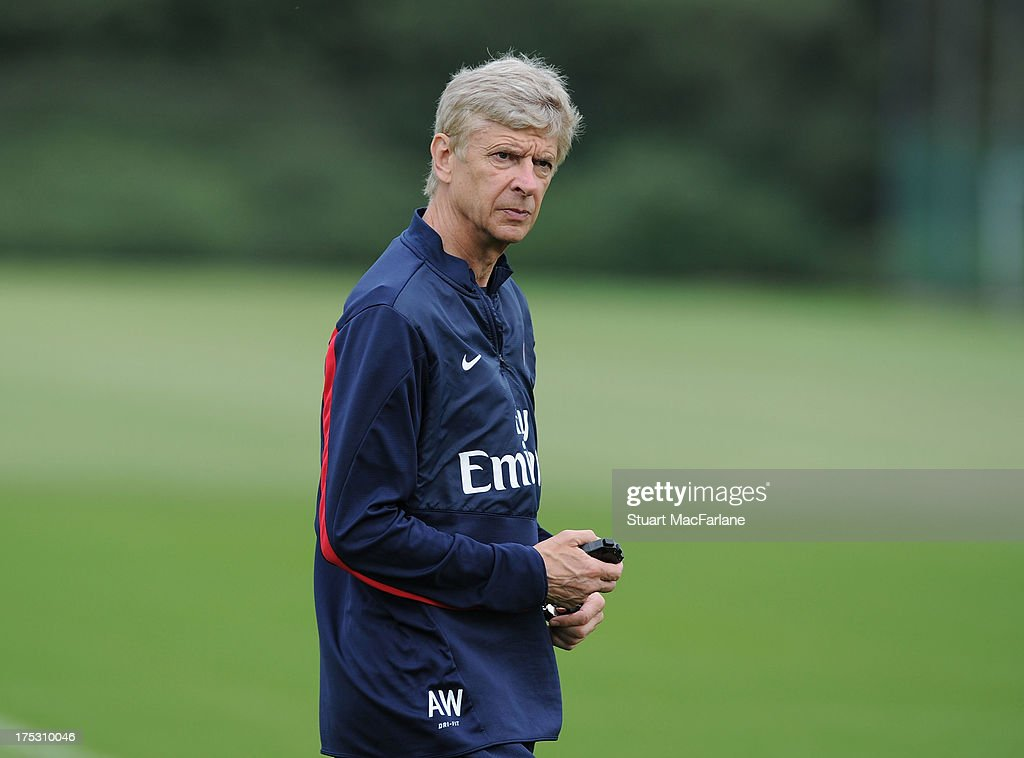 Arsenal manager <a gi-track='captionPersonalityLinkClicked' href=/galleries/search?phrase=Arsene+Wenger&family=editorial&specificpeople=171184 ng-click='$event.stopPropagation()'>Arsene Wenger</a> looks on during a training session at London Colney on August 02, 2013 in St Albans, England.