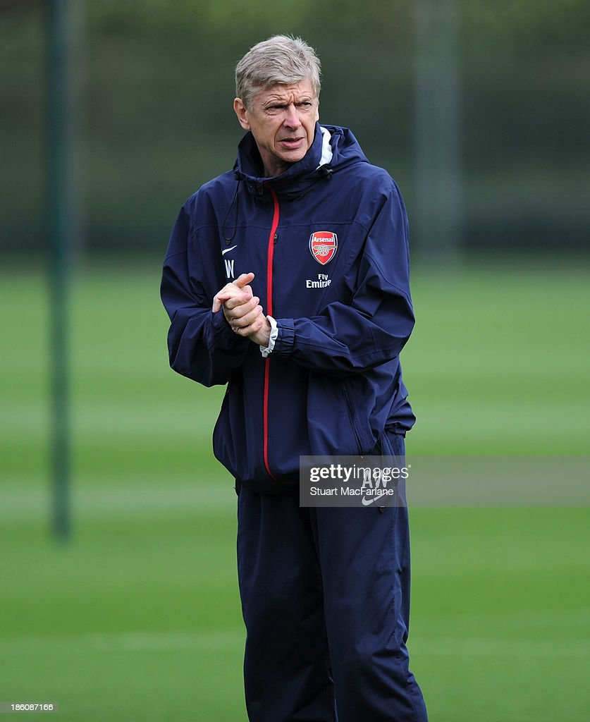 Arsenal manager <a gi-track='captionPersonalityLinkClicked' href=/galleries/search?phrase=Arsene+Wenger&family=editorial&specificpeople=171184 ng-click='$event.stopPropagation()'>Arsene Wenger</a> looks on during a training session at London Colney on October 28, 2013 in St Albans, England.