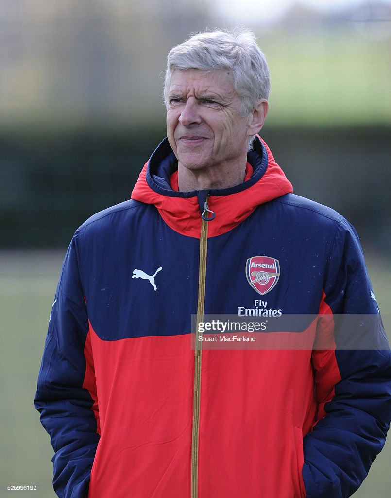 Arsenal manager <a gi-track='captionPersonalityLinkClicked' href=/galleries/search?phrase=Arsene+Wenger&family=editorial&specificpeople=171184 ng-click='$event.stopPropagation()'>Arsene Wenger</a> looks on during a training session at London Colney on April 29, 2016 in St Albans, England.