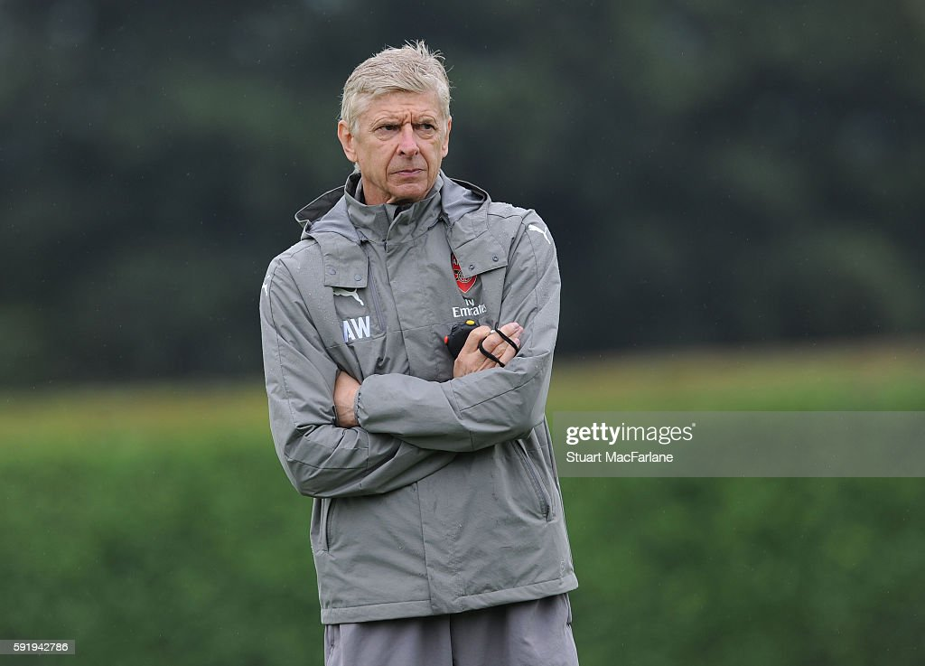 Arsenal manager Arsene Wenger looks on during a training session at London Colney on August 19 2016 in St Albans England