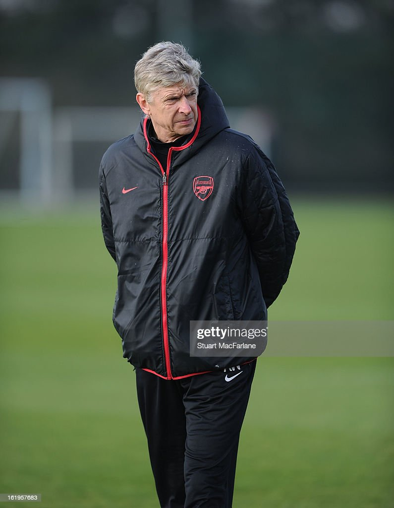 Arsenal manager Arsene Wenger looks on during a training session ahead of their UEFA Champions League match against FC Bayern Muenchen at London Colney on February 18, 2013 in St Albans, England.
