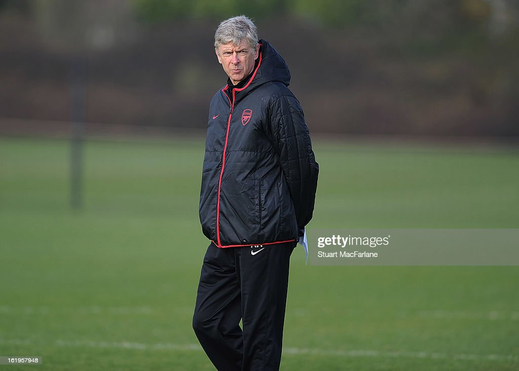 Arsenal manager <a gi-track='captionPersonalityLinkClicked' href=/galleries/search?phrase=Arsene+Wenger&family=editorial&specificpeople=171184 ng-click='$event.stopPropagation()'>Arsene Wenger</a> looks on during a training session ahead of their UEFA Champions League match against FC Bayern Muenchen at London Colney on February 18, 2013 in St Albans, England.