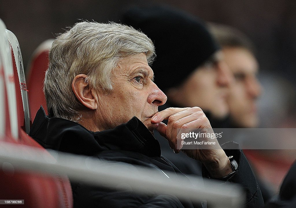 Arsenal manager Arsene Wenger looks on during the Barclays Premier League match between Arsenal and Newcastle United at Emirates Stadium on December 29, 2012 in London, England.