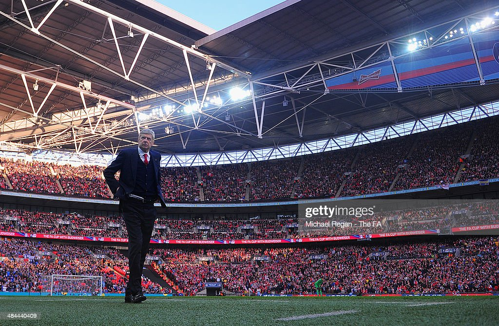 Arsenal manager Arsene Wenger looks on during the FA Cup Semi-Final match between Wigan Athletic and Arsenal at Wembley Stadium on April 12, 2014 in London, England.