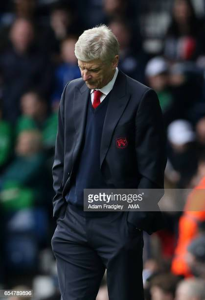 Arsenal Manager Arsene Wenger looks on during the Premier League match between West Bromwich Albion and Arsenal at The Hawthorns on March 18 2017 in...