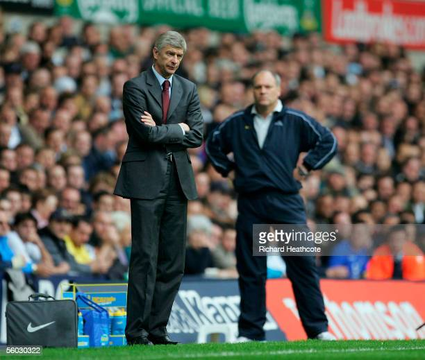 Arsenal manager Arsene Wenger looks on shadowed by Tottenham manager Martin Jol the during the Barclays Premiership match between Tottenham Hotspur...