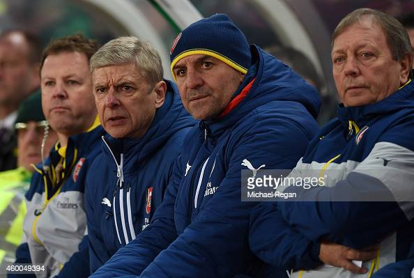 Arsenal Manager Arsene Wenger looks on with Steve Bould during the Barclays Premier League match between Stoke City and Arsenal at the Britannia...
