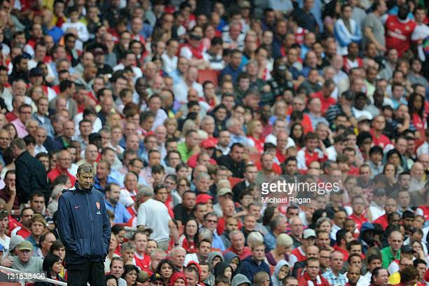 Arsenal manager Arsene Wenger looks thoughtful during the Barclays Premier League match between Arsenal and Liverpool at the Emirates Stadium on...