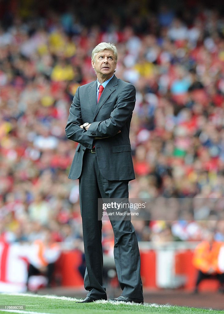 Arsenal manager <a gi-track='captionPersonalityLinkClicked' href=/galleries/search?phrase=Arsene+Wenger&family=editorial&specificpeople=171184 ng-click='$event.stopPropagation()'>Arsene Wenger</a> looks to the sky during the Barclays Premier League match between Arsenal and Aston Villa at Emirates Stadium on August 17, 2013 in London, England. Arsenal went on to lose the game 3 - 1.
