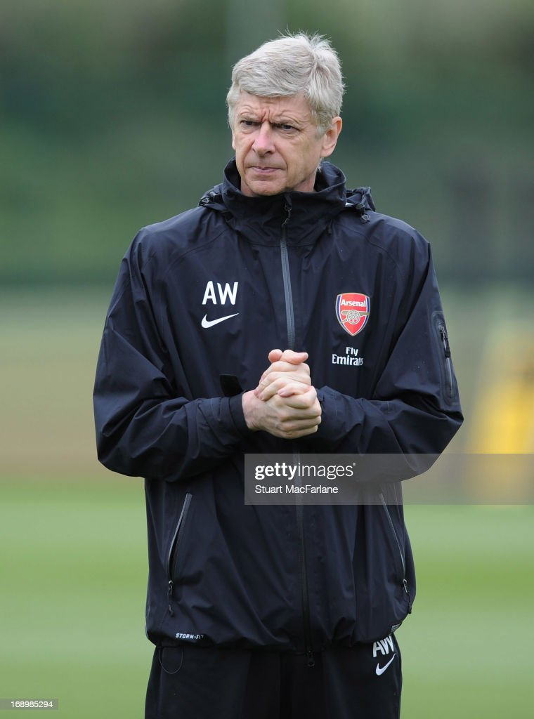 Arsenal manager <a gi-track='captionPersonalityLinkClicked' href=/galleries/search?phrase=Arsene+Wenger&family=editorial&specificpeople=171184 ng-click='$event.stopPropagation()'>Arsene Wenger</a> oversees a training session at London Colney on May 18, 2013 in St Albans, England.