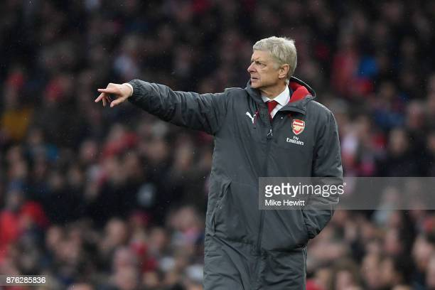 Arsenal manager Arsene Wenger points during the Premier League match between Arsenal and Tottenham Hotspur at Emirates Stadium on November 18 2017 in...