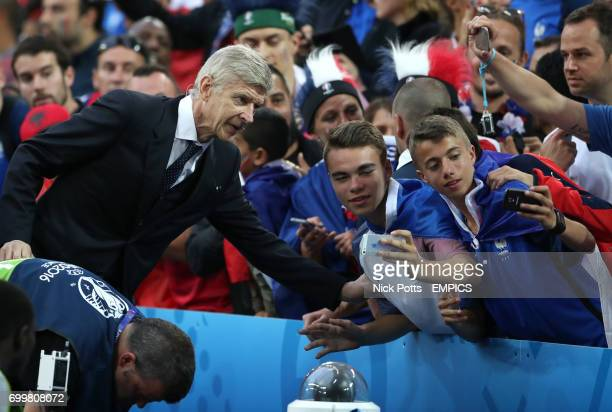 Arsenal manager Arsene Wenger poses for photos with spectators