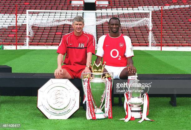 Arsenal manager Arsene Wenger poses with captain Patrick Vieira and the Community Shield Premier Leage trophy and FA Cup at Arsenal Stadium Highbury...