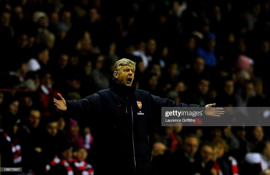 Arsenal Manager Arsene Wenger reacts during the FA Cup Fifth Round match between Sunderland and Arsenal at The Stadium of Light on February 18, 2012 in Sunderland, England.