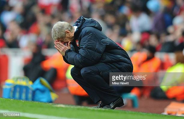 Arsenal manager Arsene Wenger reacts to Tottenham's winning goal during the Barclays Premier League match between Arsenal and Tottenham Hotspur at...
