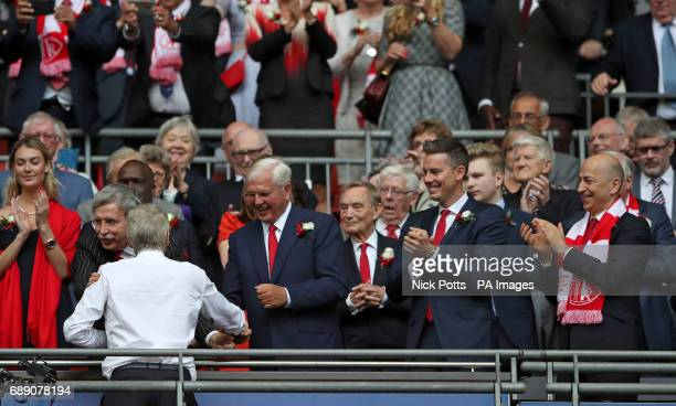 Arsenal manager Arsene Wenger shakes hands with Arsenal majority owner Stan Kroenke during the Emirates FA Cup Final at Wembley Stadium London