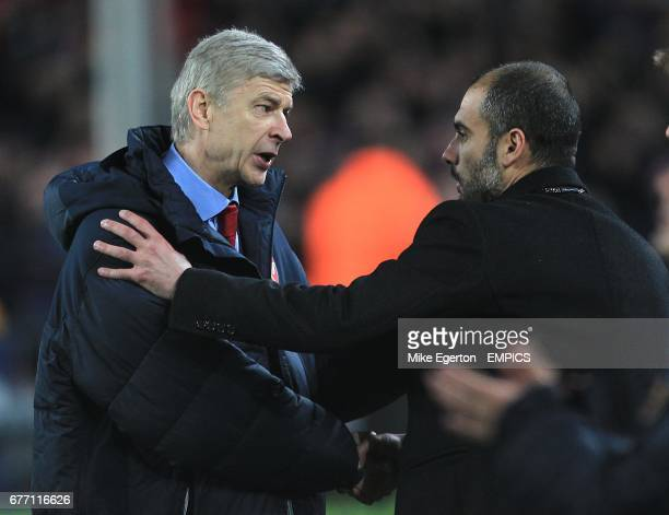 Arsenal manager Arsene Wenger shakes hands with Barcelona manager Josep Guardiola after the final whistle