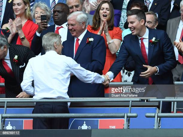 Arsenal manager Arsene Wenger shakes hands with director Josh Kroenke after the Emirates FA Cup Final between Arsenal and Chelsea at Wembley Stadium...