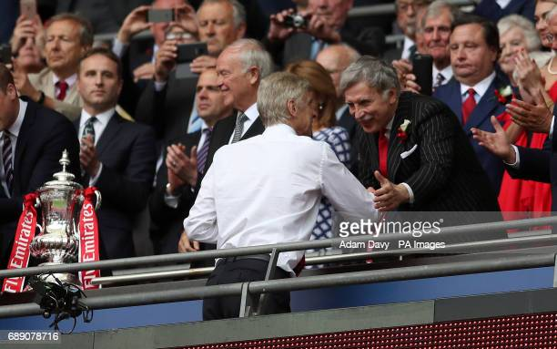 Arsenal manager Arsene Wenger shakes hands with Owner Stan Kroenke after the final whistle during the Emirates FA Cup Final at Wembley Stadium London