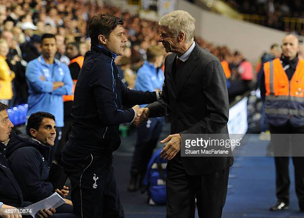 Arsenal manager Arsene Wenger shakes hands with Tottenham manager Mauricio Pochettino before the Capital One Cup Third Round match between Tottenham...