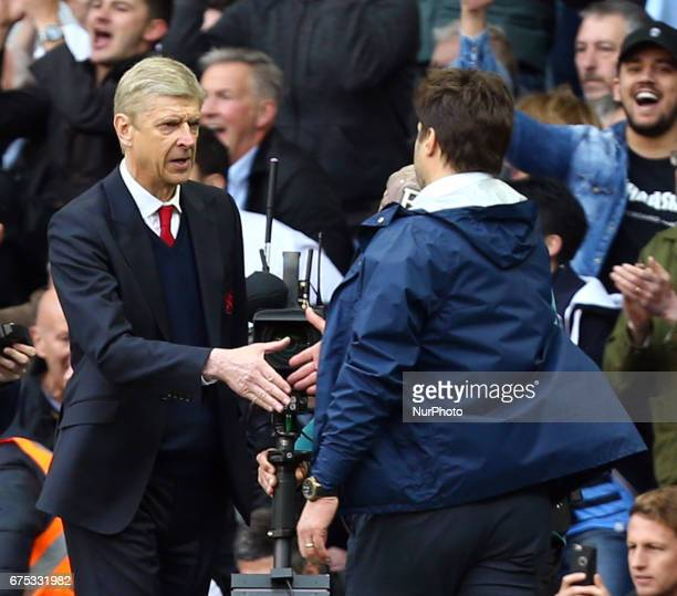 Arsenal manager Arsene Wenger shanks hands with Tottenham Hotspur manager Mauricio Pochettino during the Premier League match between Tottenham...