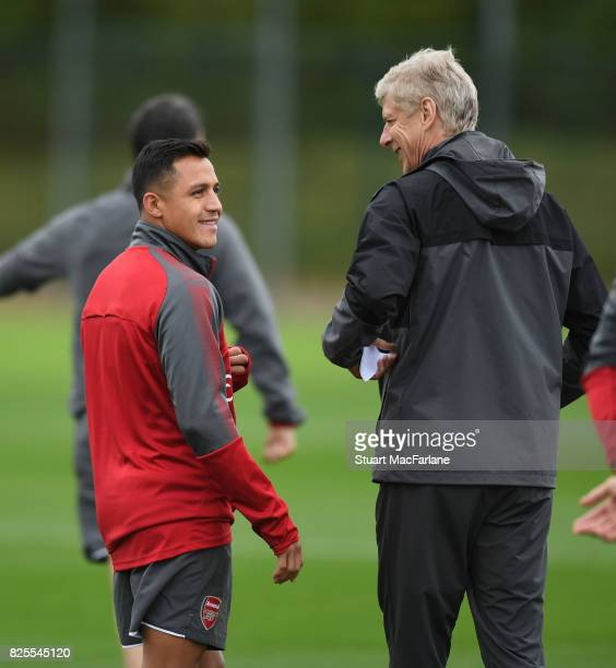 Arsenal manager Arsene Wenger shares a joke with Alexis Sanchez during a training session at London Colney on August 2 2017 in St Albans England