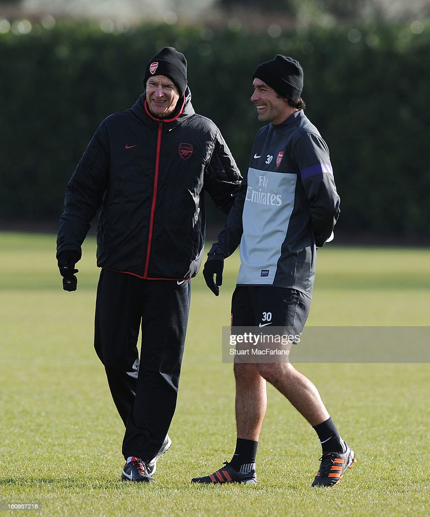 Arsenal manager <a gi-track='captionPersonalityLinkClicked' href=/galleries/search?phrase=Arsene+Wenger&family=editorial&specificpeople=171184 ng-click='$event.stopPropagation()'>Arsene Wenger</a> shares a joke with ex player <a gi-track='captionPersonalityLinkClicked' href=/galleries/search?phrase=Robert+Pires&family=editorial&specificpeople=167225 ng-click='$event.stopPropagation()'>Robert Pires</a> during a training session at London Colney on February 08, 2013 in St Albans, England.