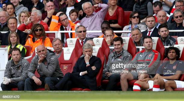 Arsenal manager Arsene Wenger sits in the dugout during the Premier League match at the Emirates Stadium London