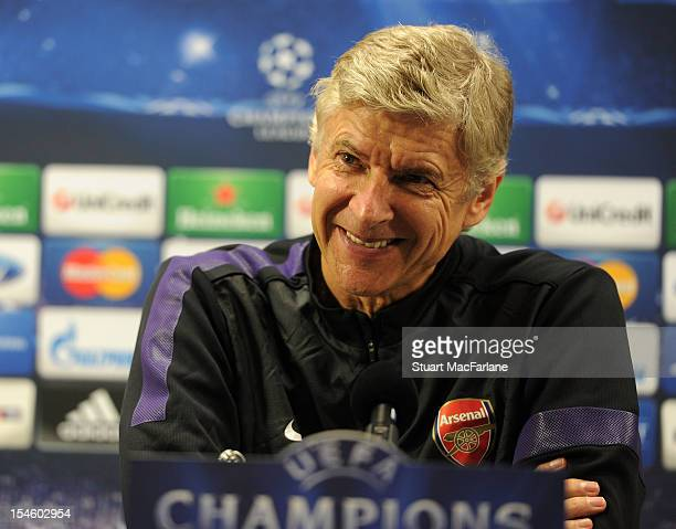Arsenal manager Arsene Wenger smiles during a press conference ahead of their UEFA Champions League group stage match against Schalke 04 at London...