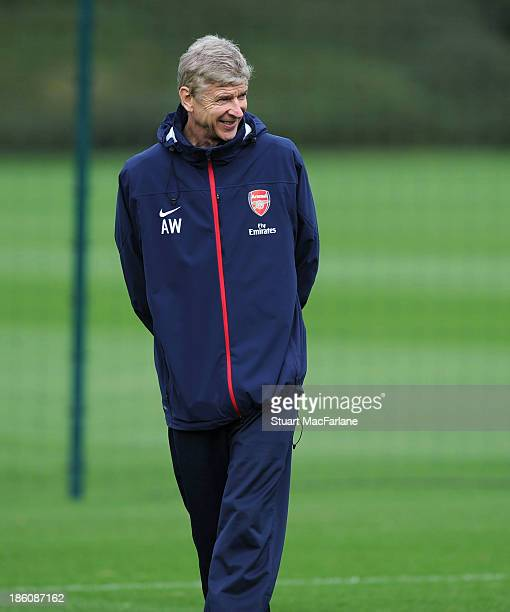 Arsenal manager Arsene Wenger smiles during a training session at London Colney on October 28 2013 in St Albans England