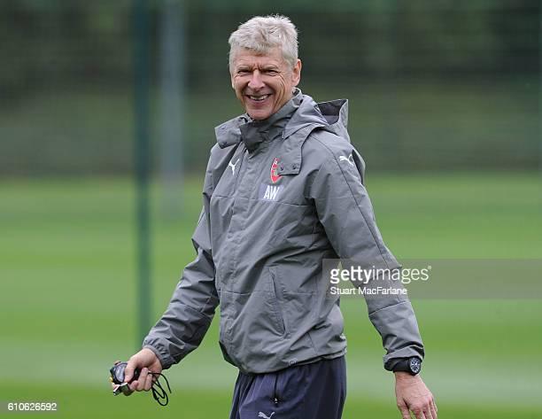 Arsenal manager Arsene Wenger smiles during a training session at London Colney on September 27 2016 in St Albans England
