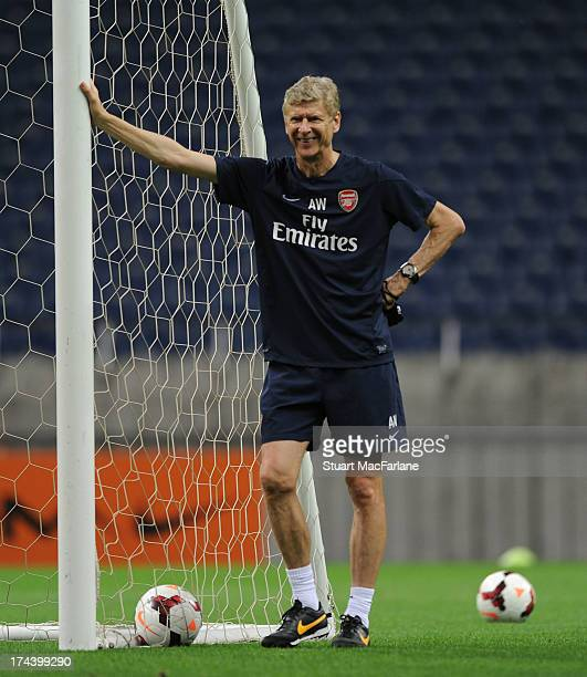 Arsenal manager Arsene Wenger smiles during a training session in Japan for the club's preseason Asian tour at the Saitama Stadium on July 25 2013 in...