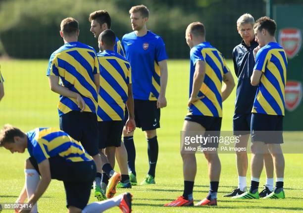 Arsenal manager Arsene Wenger speaks to his players during a training session at London Colney St Albans