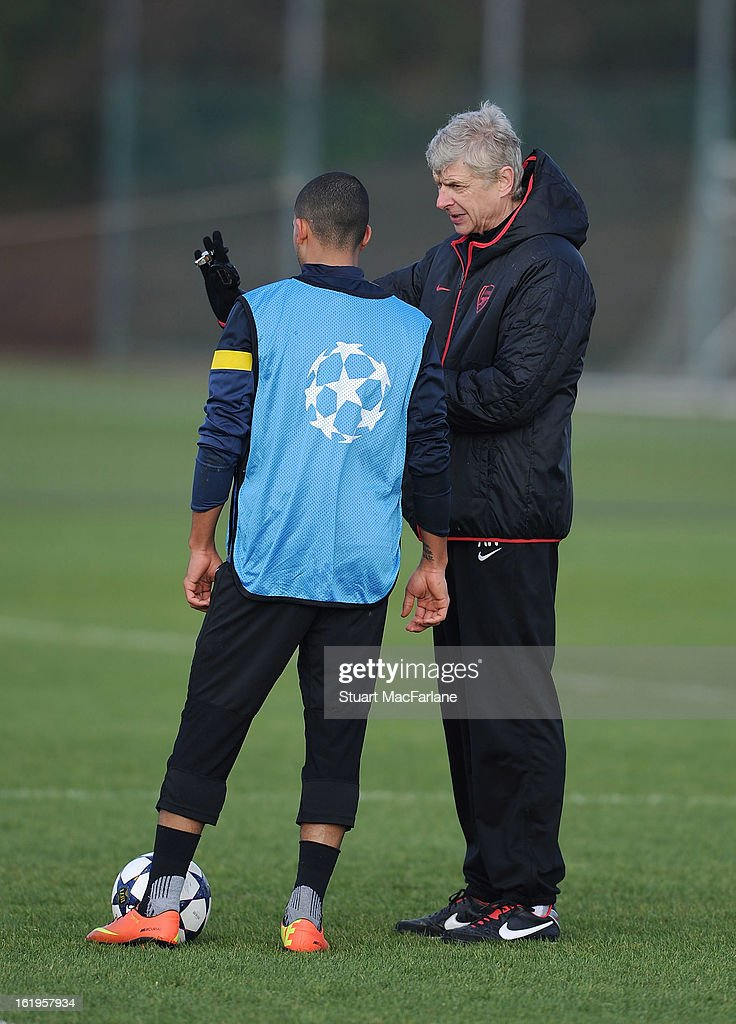 Arsenal manager Arsene Wenger speaks to Theo Walcott during a training session ahead of their UEFA Champions League match against FC Bayern Muenchen at London Colney on February 18, 2013 in St Albans, England.