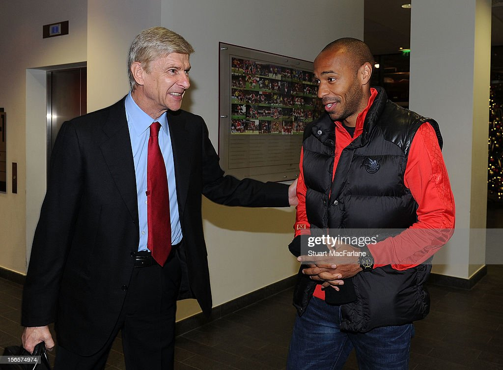 Arsenal manager Arsene Wenger speaks with former Arsenal player Thierry Henry before the Barclays Premier League match between Arsenal and Tottenham Hotspur, at Emirates Stadium on November 17, 2012 in London, England.
