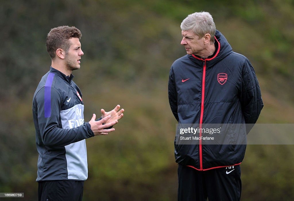 Arsenal manager Arsene Wenger speaks with Jack Wilshere during a training session at London Colney on April 19, 2013 in St Albans, England.