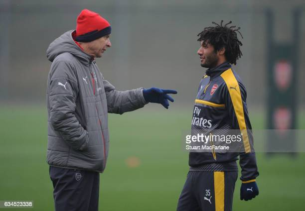 Arsenal manager Arsene Wenger speaks with Mohamed Elneny during a training session at London Colney on February 10 2017 in St Albans England