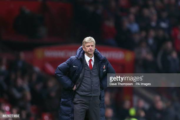 Arsenal manager Arsene Wenger stands hands on hips on the touchline