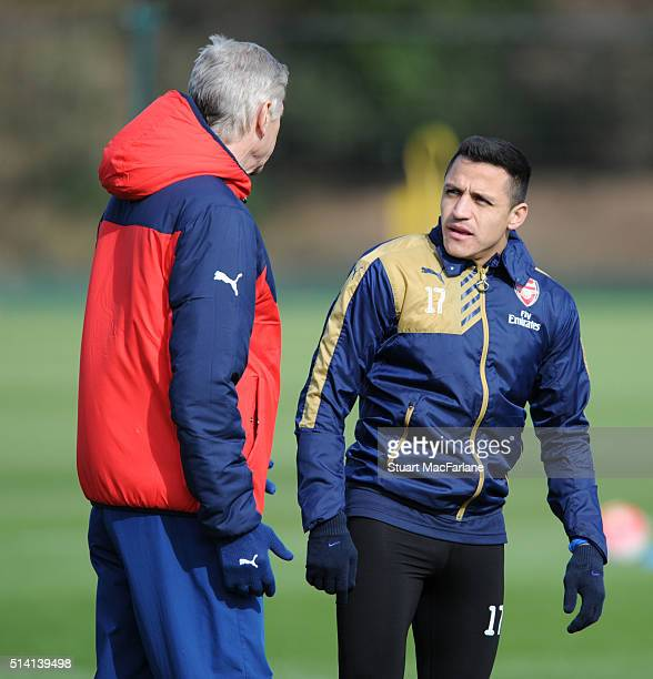 Arsenal manager Arsene Wenger talks to Alexis Sanchez before a training session at London Colney on March 7 2016 in St Albans England