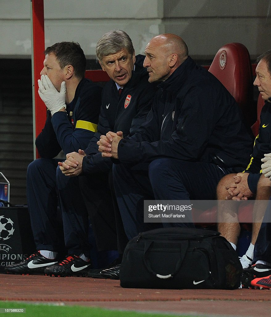 Arsenal manager <a gi-track='captionPersonalityLinkClicked' href=/galleries/search?phrase=Arsene+Wenger&family=editorial&specificpeople=171184 ng-click='$event.stopPropagation()'>Arsene Wenger</a> talks to assistant Steve Bould during the UEFA Champions League Group B match between Olympiacos FC and Arsenal FC at Georgios Karaiskakis Stadium on December 04, 2012 in Athens, Greece.
