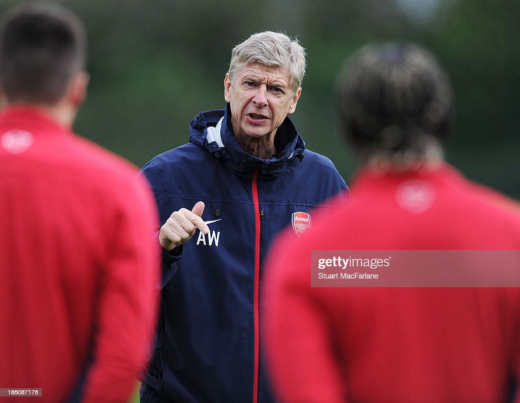 Arsenal manager <a gi-track='captionPersonalityLinkClicked' href=/galleries/search?phrase=Arsene+Wenger&family=editorial&specificpeople=171184 ng-click='$event.stopPropagation()'>Arsene Wenger</a> talks to his players during a training session at London Colney on October 28, 2013 in St Albans, England.