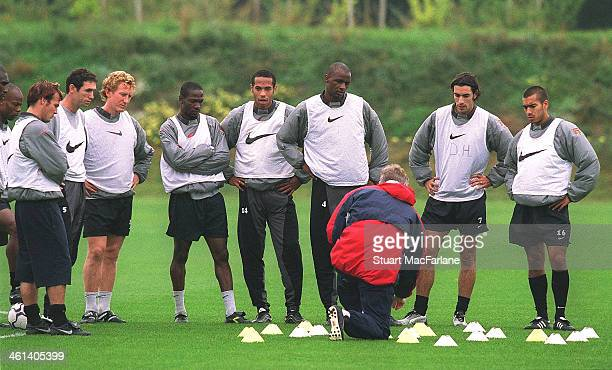 Arsenal manager Arsene Wenger talks to his players Freddie Ljungberg Martin Keown Ray Parlour Lauren Thierry Henry Patrick Vieira Robert Pires and...