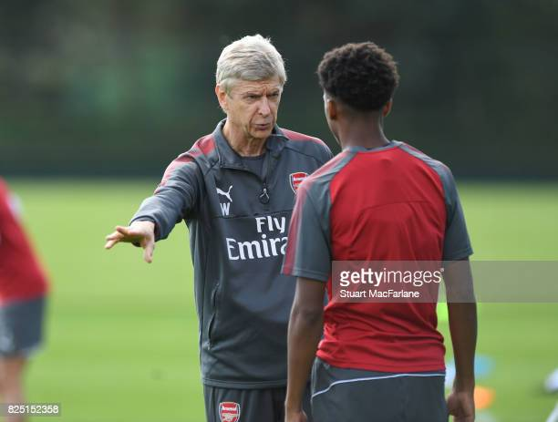Arsenal manager Arsene Wenger talks to Joe Willock during a training session at London Colney on August 1 2017 in St Albans England