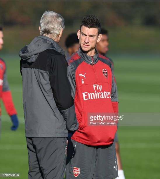 Arsenal manager Arsene Wenger talks to Laurent Koscielny during a training session at London Colney on November 17 2017 in St Albans England